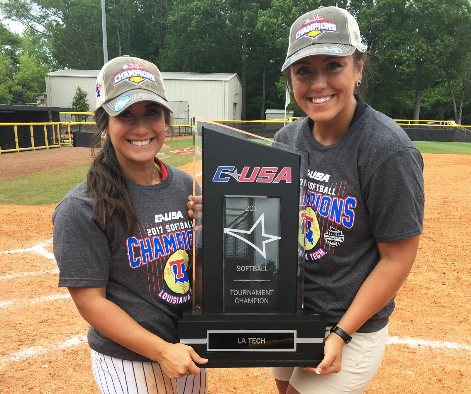 Jessica Ball (left) and Bianca Duran hold the CUSA championship trophy. The two former Cougars will be leading LA Tech at the NCAA national tournament in the Alabama region this weekend. Ball is a senior for LA Tech while Duran is an assistant coach.