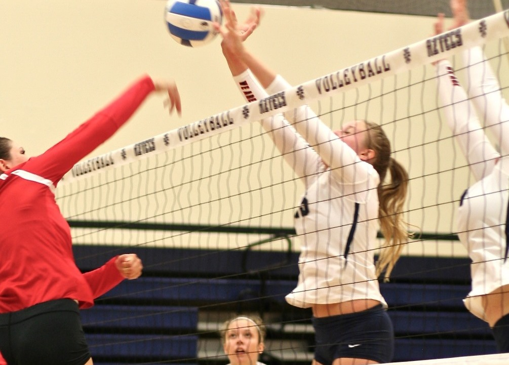 Freshman Kendall Deeter (Mountain View HS) would not be denied as she finished with nine blocks to go along with five kills as the Aztecs upset No. 5 Mesa in five sets. The Aztecs are 3-3 overall and 2-0 in ACCAC conference play. Photo by Stephanie Van Latum