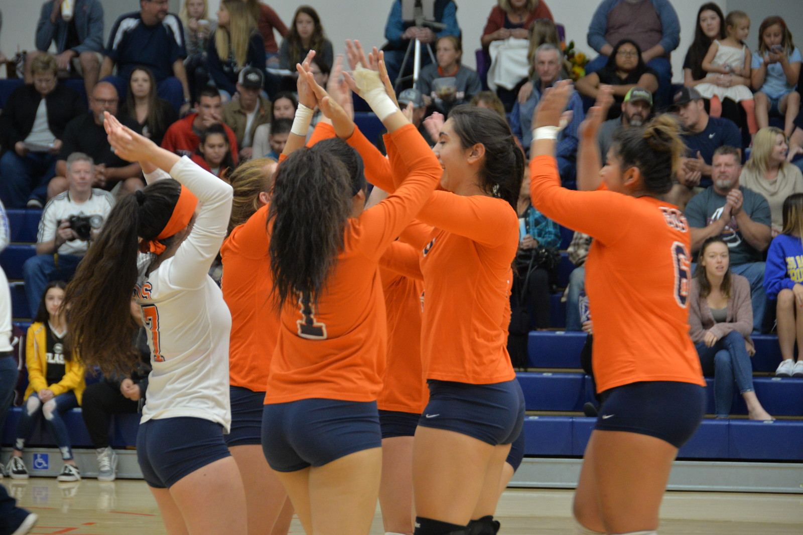 COS Volleyball clapping hands in a match earlier this year.