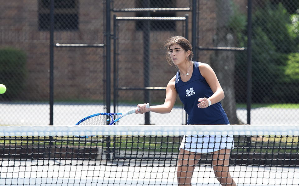 Cristina Merone returns a shot at the net versus Immaculata University at Hoffman Courts.