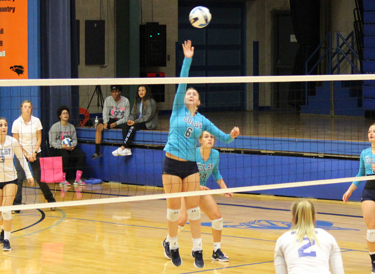 Freshman Brynn Niblock tips the ball over the net in Colby's sweep of Pratt Oct. 23 at the Colby Community Building.