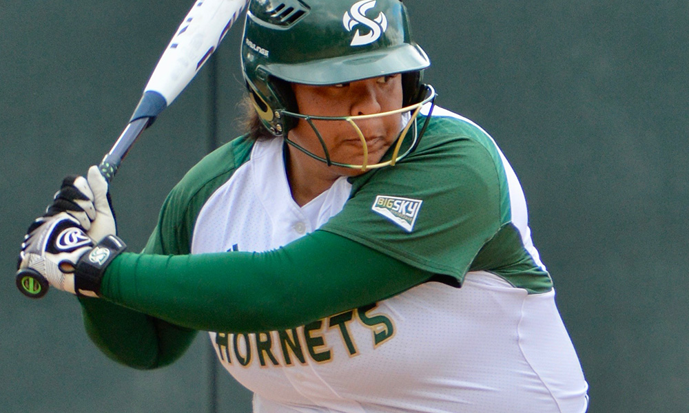 PLAYING IN FRIGID CONDITIONS, SOFTBALL OUTLASTS NEW MEXICO, 15-12, IN SLUG FEST