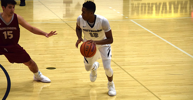 Elijah Davis '20 dribbles to set up the offense versus Muhlenberg College.