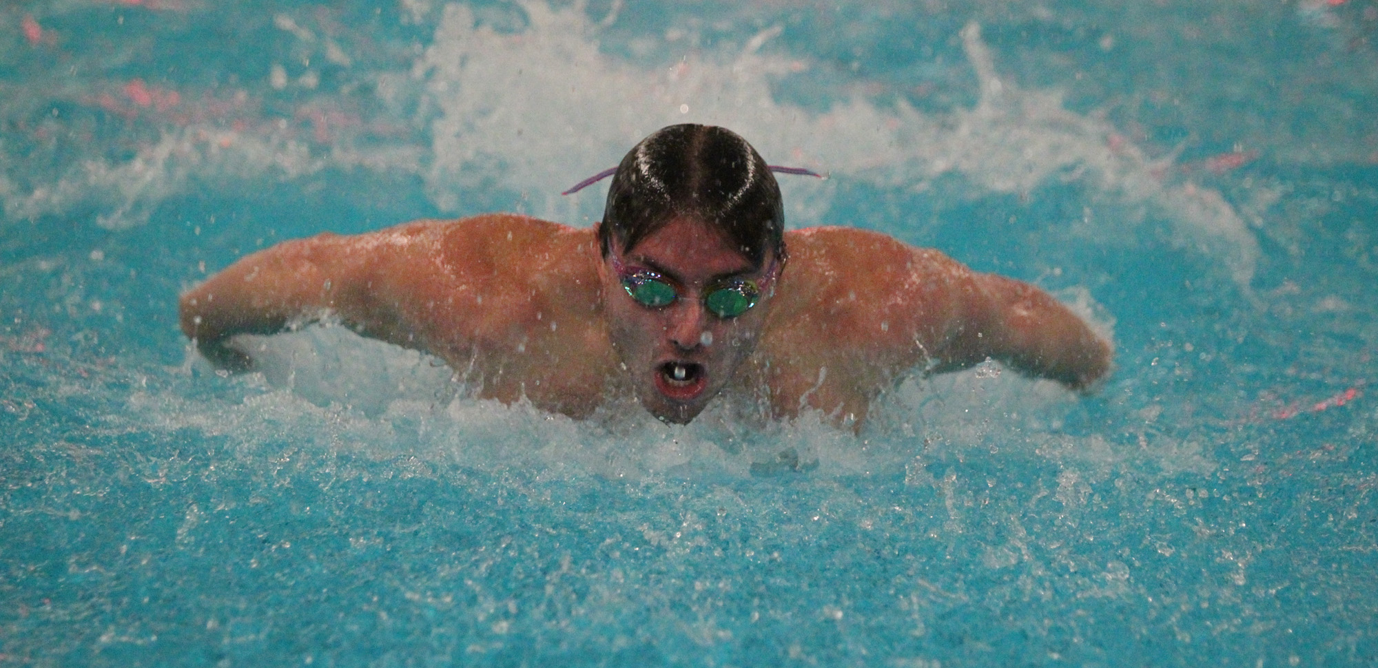 Senior Timothy Quigley helped Scranton's 400-medley relay team break the Ranger Invitational record in the event on Friday.