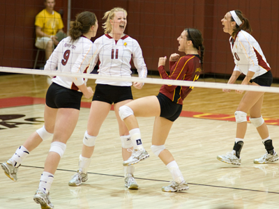 Setter Samantha Fordyce (#11) and her teammates celebrate a point in Ferris State's 3-1 win over West Virginia State at the Ferris State Invitational.