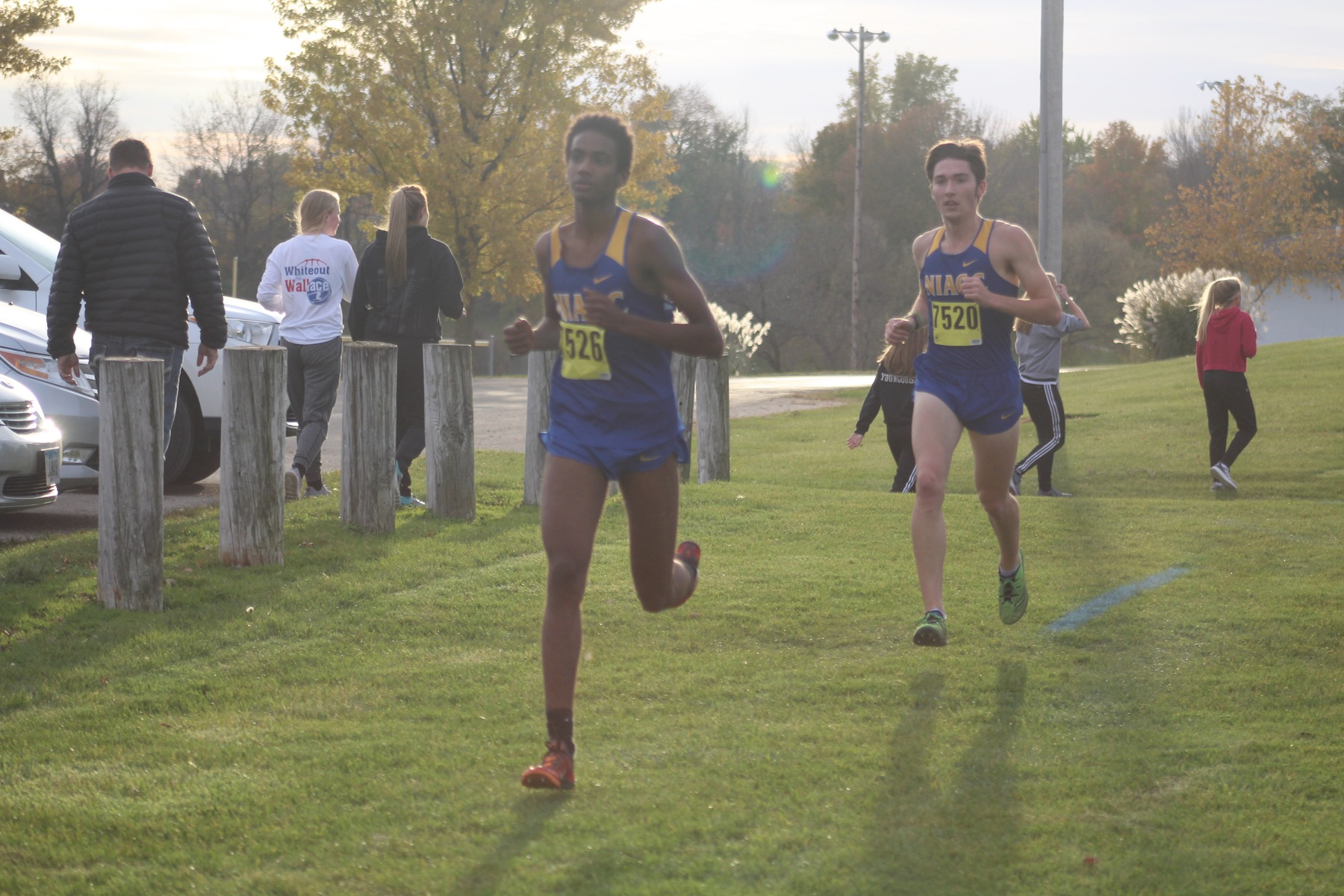 NIACC's Abdiaziz Wako (front) and Gavin Connell run at Friday's regional meet.