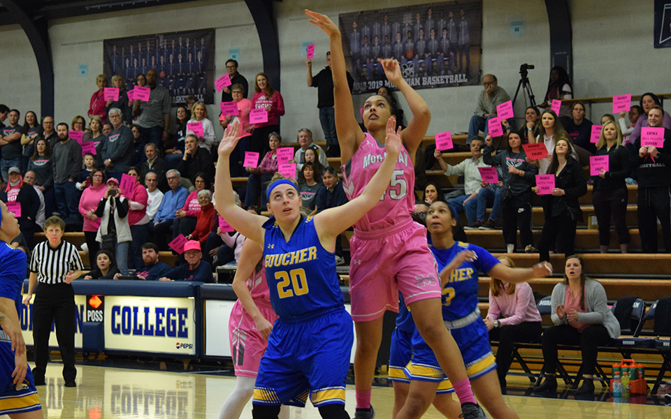 Junior forward Nadine Ewald takes a jumper in the lane during the first half versus Goucher College in annual Play4Kay game.