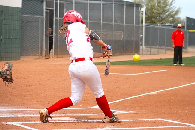 Mesa's Ryann Holmes ropes a double off the right field wall in the first inning of game one Saturday afternoon. (Photo by Aaron Webster)
