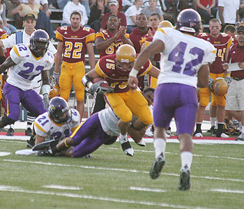 FSU's Aaron Olman tries to stay on his feet (Photo by Big Rapids Pioneer)