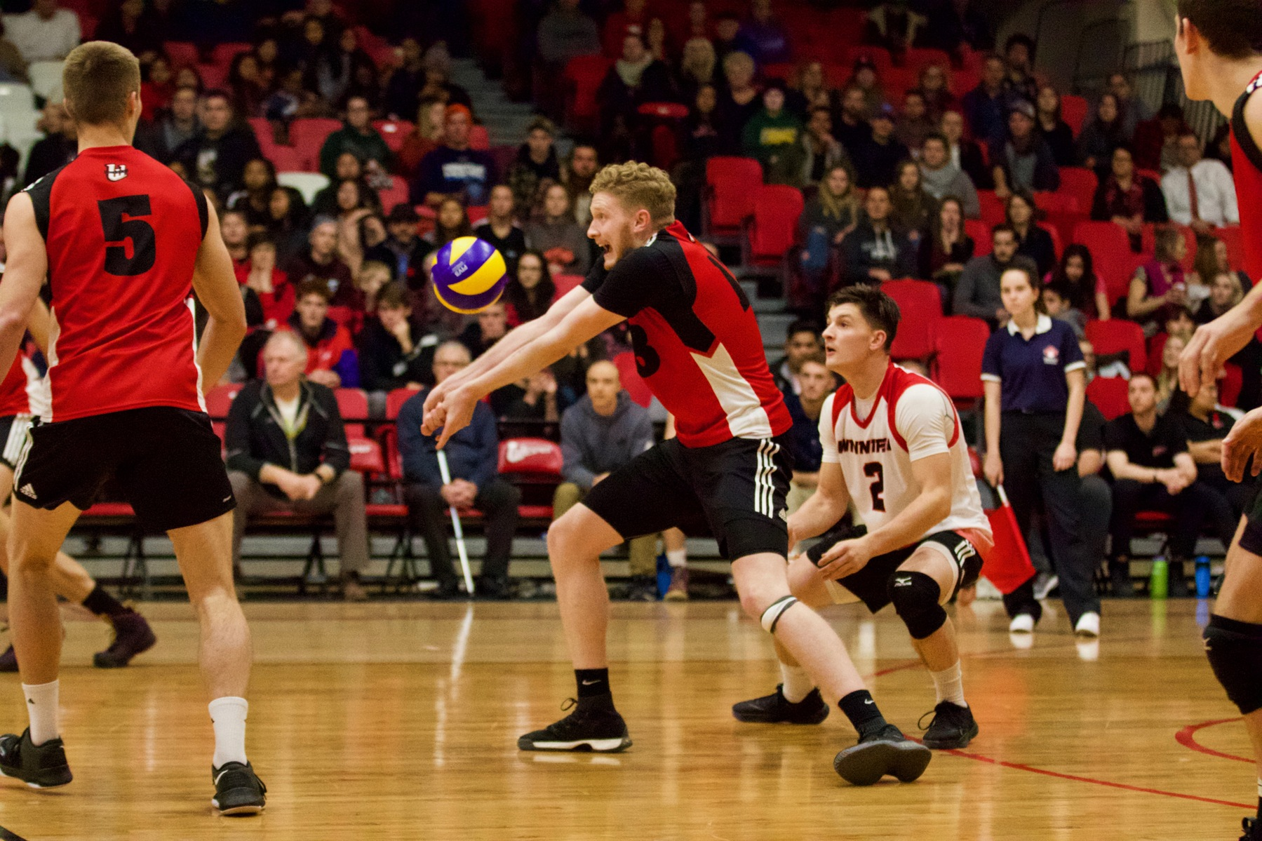 Left side Ethan Duncan receives a serve in the first half of the Wesmen's match against the Trinity Western Spartans, Nov. 9, 2018. (David Larkins/Wesmen Athletics)