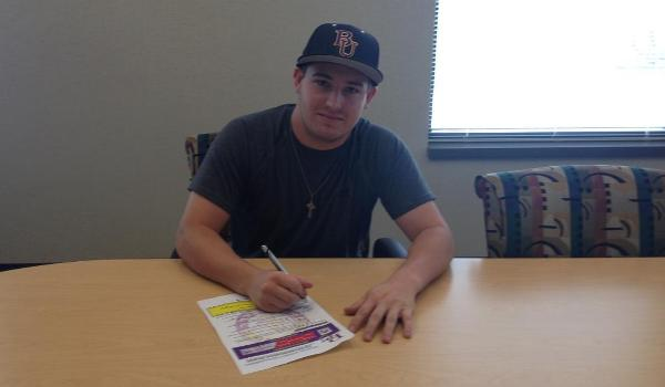 Former Millard North and New Mexico State player Matt Evans signs his letter of intent