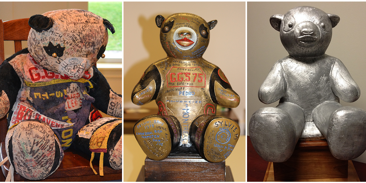 The three versions of Pedro the Panda, from left to right: the original stuffed bear, the bronze bear trophy, the new aluminum version.
