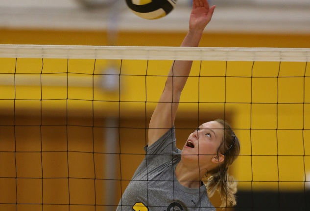 Tribune volleyball takes three regional matches