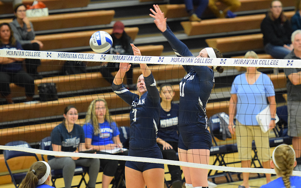Junior Victoria Kauffman and senior Erin Tiger go up for a block versus Franklin & Marshall College.