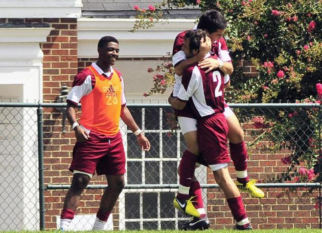 Greg Carnovale (#2) and Freddy Gomez (7) celebrate the Quakers' first goal.
