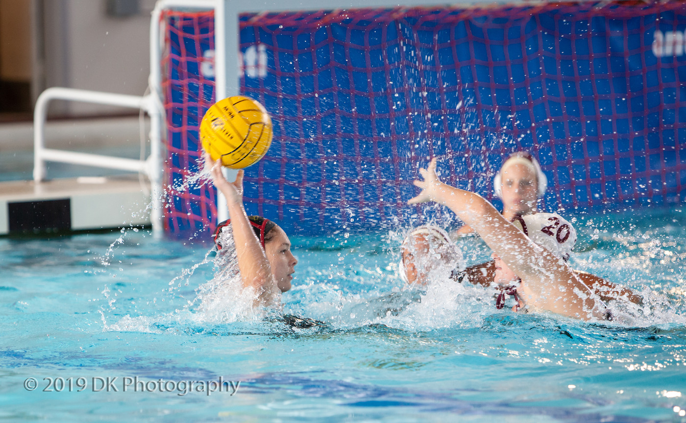 Diana Freeman (#4), City College freshman gets double teamed in the match against Sierra College at Hoos Pool on Oct. 9th.