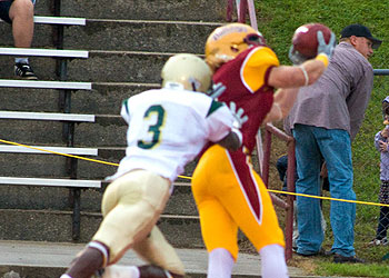 The Bulldogs try to complete a pass play (Photo by Ed Hyde)