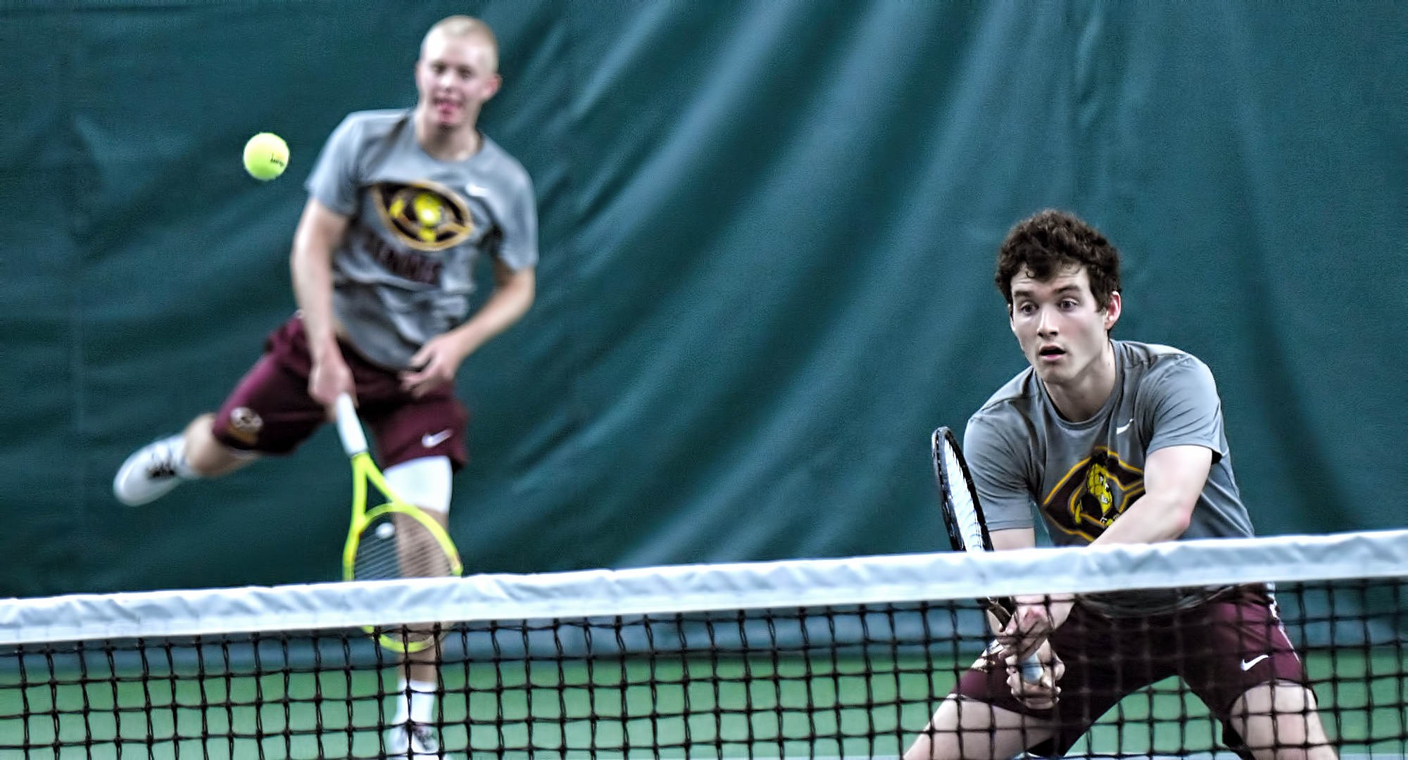 Jared Saue makes the serve and doubles partner Erik Porter waits for the return in their match at No.1 doubles. The tandem won 8-6 in their match with St. John's.