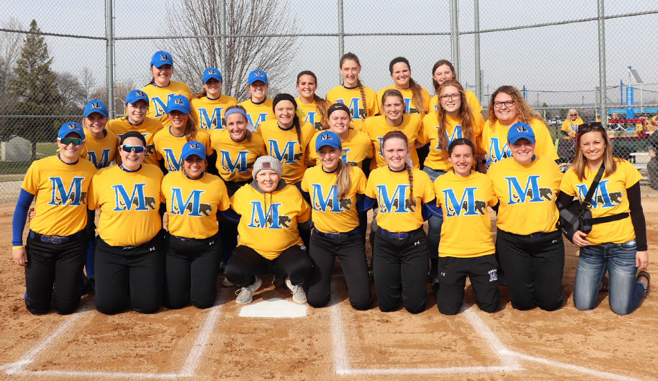 The Marian softball team takes a team picture with Courtney Makinen.