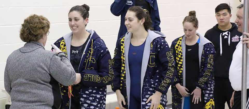 Brynna Sentel, Jacqueline Richard and Jessica Halsmer accept their gold medals for the 800 freestyle relay (photo courtesy of Rose-Hulman athletics)