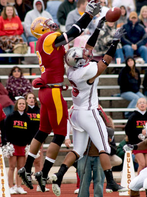 Ferris' Chris Wilson leaps to catch a pass that was intercepted (Photo by Ed Hyde)