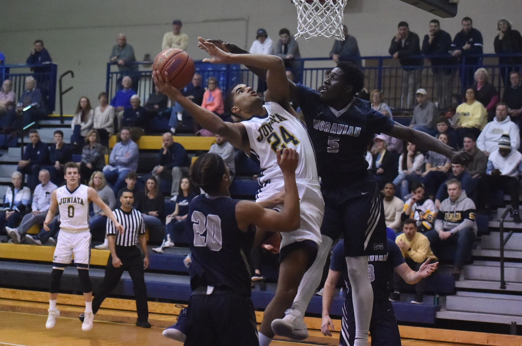 Marcus Lee scores two of his 17 points against Moravian.