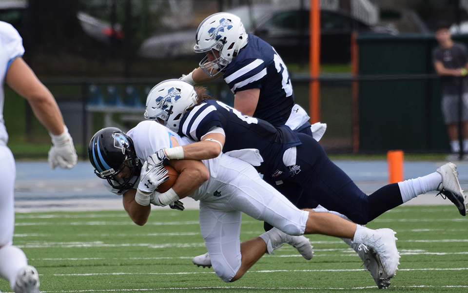 Seniors Nick Zambelli and Jacob Kober make a tackle versus Johns Hopkins University.