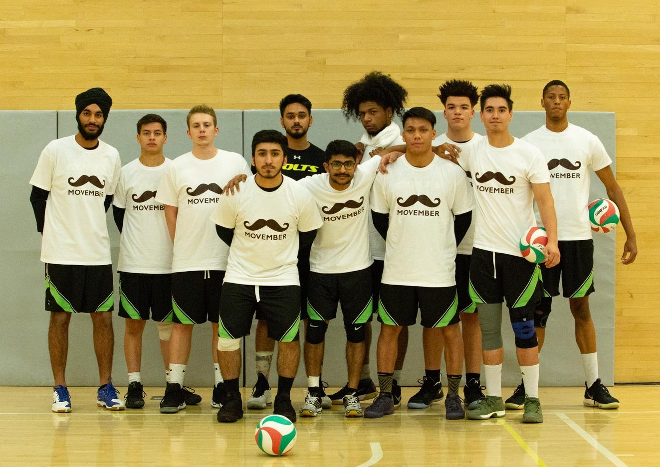 The men's team poses in their Movember shirts just before tip off against the George Brown Huskies on Thursday night. (Nicole Ventura/Colts Media)