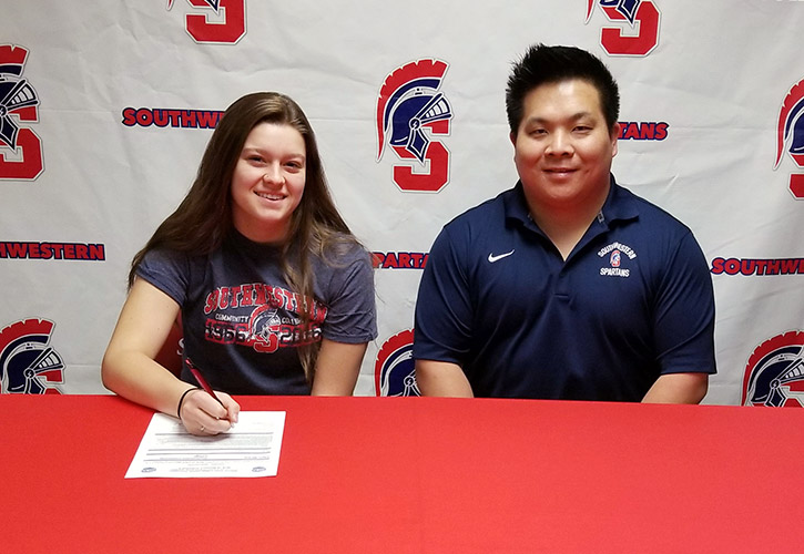 Pictured (L to R): Taylor Miracle and Casey Quiggle, Southwestern head volleyball coach