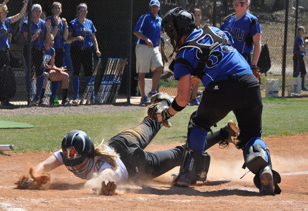 Freshman Dani Gravett scores in the first inning of Game 1 against Christopher Newport.
