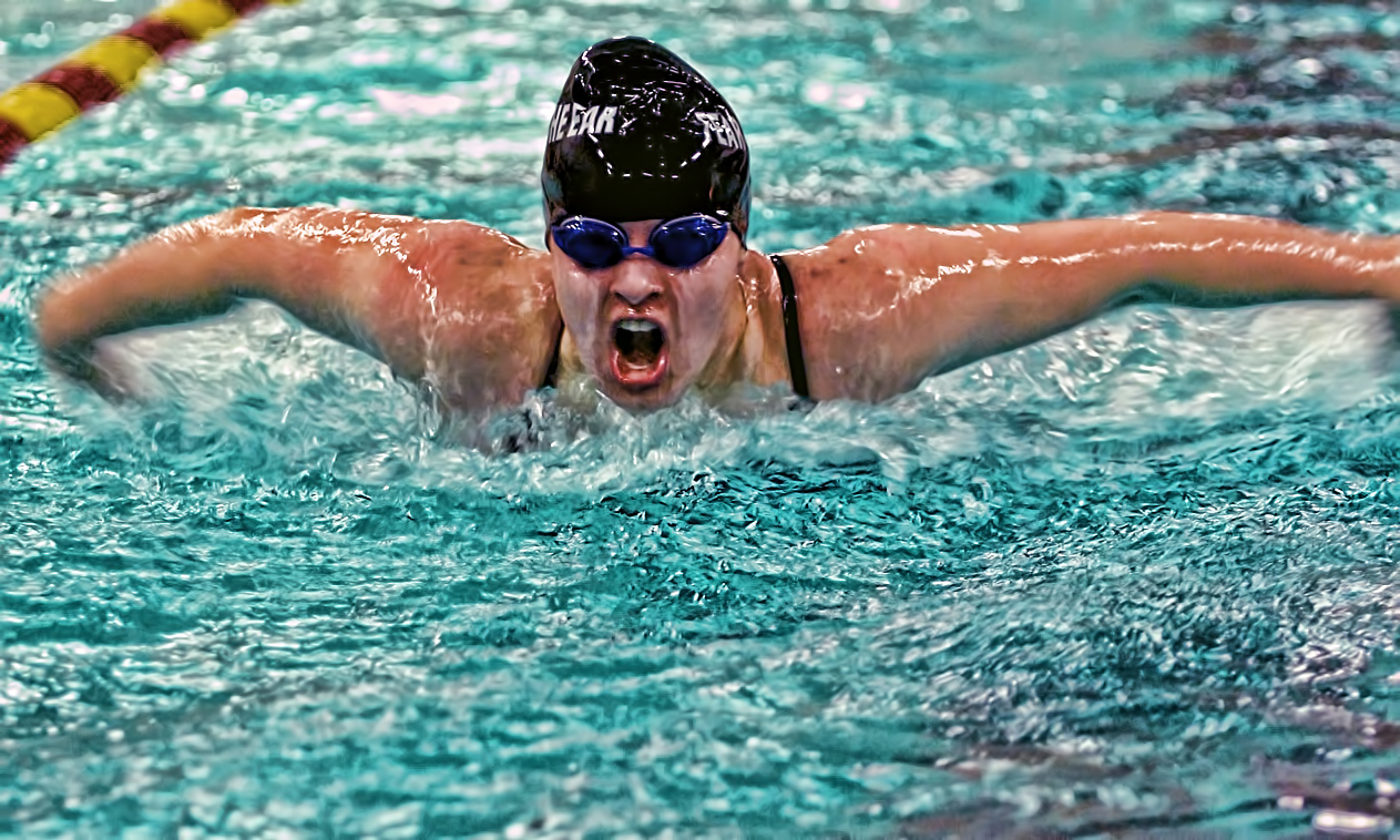 Junior Sarah Nelson races towards the wall in the 100-yard butterfly. She finished second in the event and won the 100-yard freestyle.
