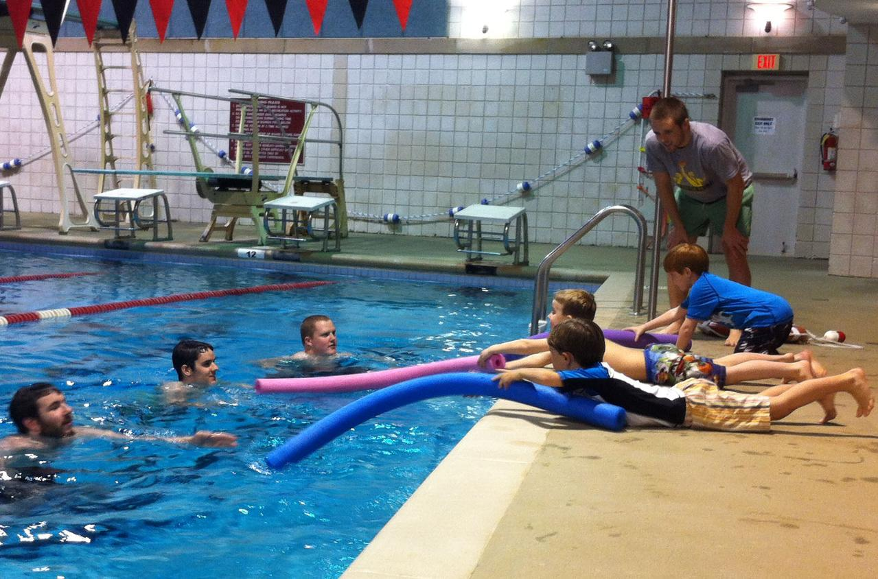 Swimming: Swimmers lead service project to help local Cub Scout den