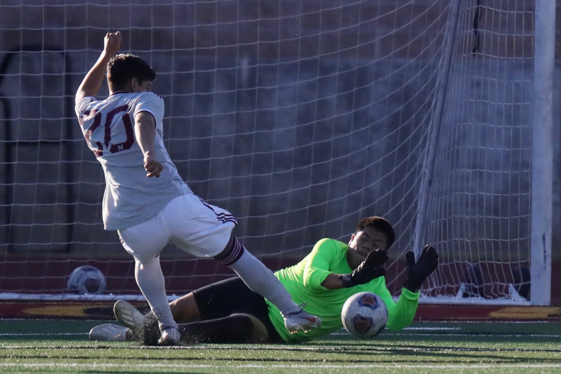 Lancer goalie Steven Sandoval goes down to make a save during PCC's loss to top-rated Mt. San Antonio Tuesday at Robinson Stadium, photo by Michael Watkins.