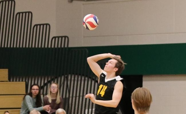 Chris Corcoran (14) tied the school record with 5 aces in the loss to Medaille