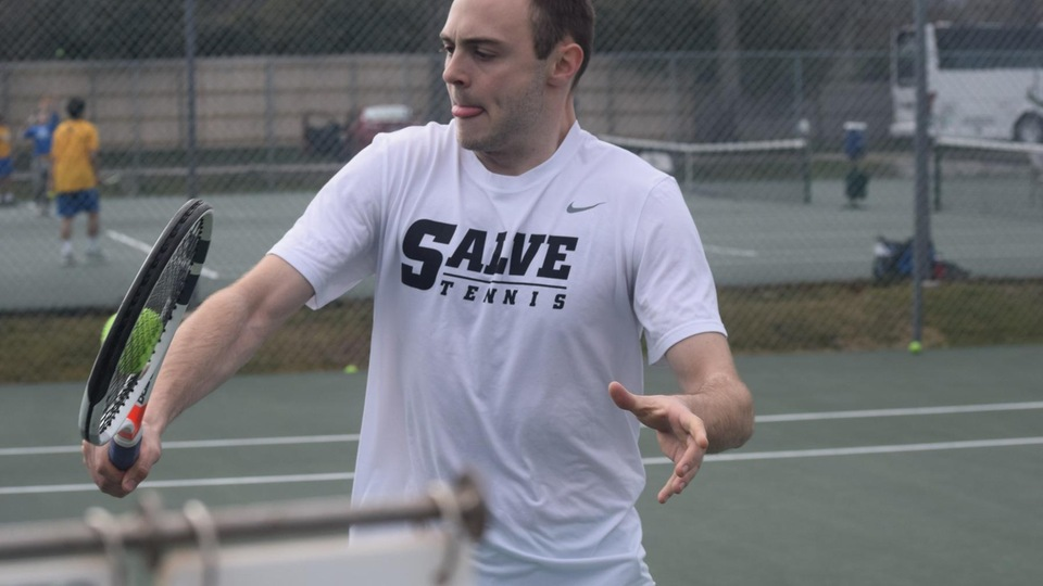 Kevin Brocks meets a backhand volley at the net. (Photo by Ed Habershaw)