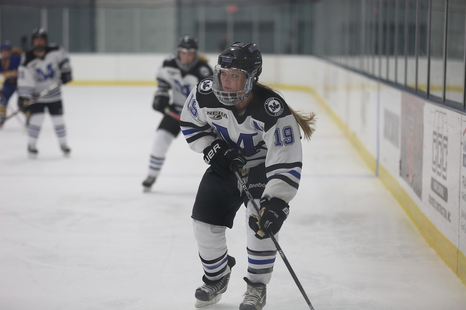 Abbey Dokken looks up with the puck.