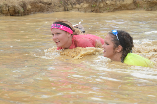Golden Eagle softball team gets down and dirty in mud run
