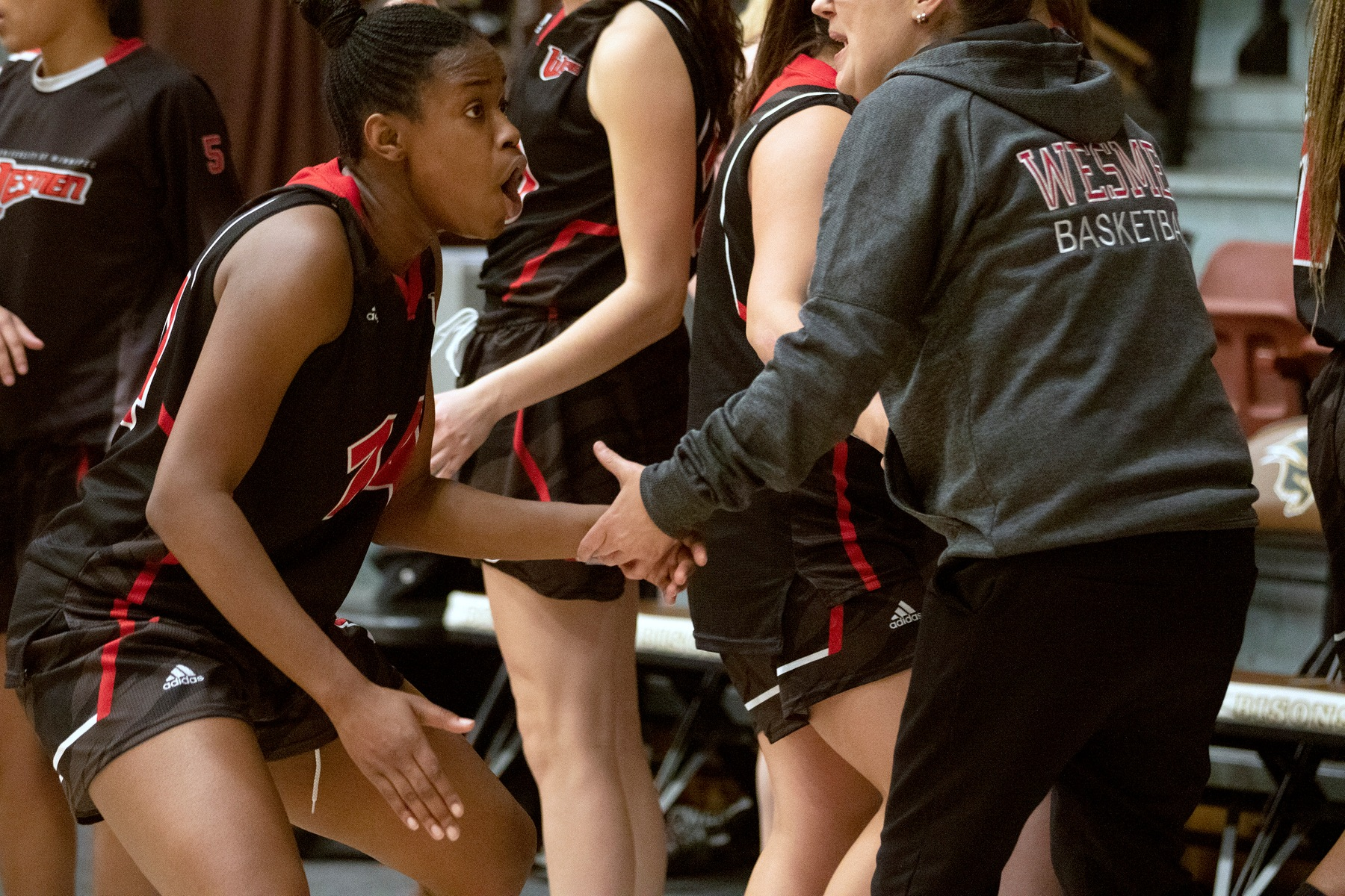 Deb Nkiasi celebrates on the sideline after the Wesmen women's basketball team defeated the Manitoba Bisons in Canada West conference action Thursday, Nov. 21, 2019 at the Investors Group Athletic Centre. (David Larkins/Wesmen Athletics)