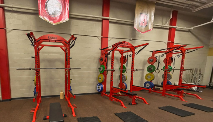 olympic lift platforms in the renovated weight room