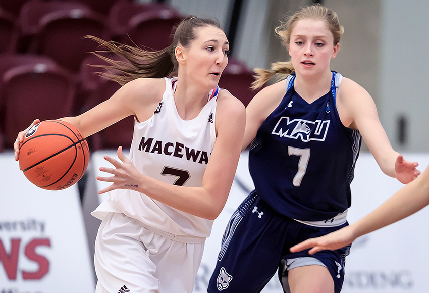 Mackenzie Farmer drives around MRU's Abbey Gillette on Friday (Robert Antoniuk photo).