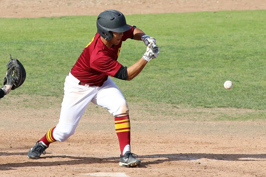 Part of PCC head coach Pat McGee's offensive plan is moving runners over. Andres Kim drops a bunt here in a recent game, photo by Richard Quinton.