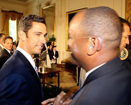 New York Yankees catcher Jorge Posada greets Coach Curtis Pride.
