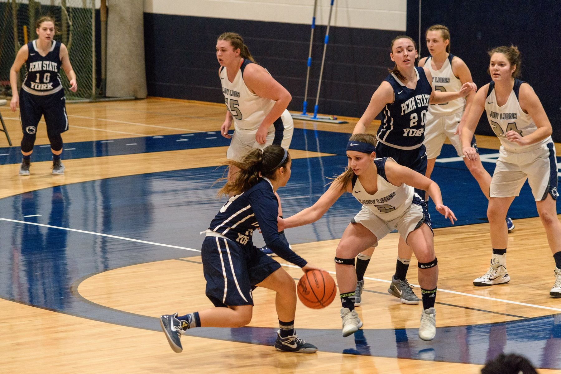Corina Rivera (with ball) tries to find an opening in the Penn State Schuylkill defense as Karra Thomason (#20) looks on.