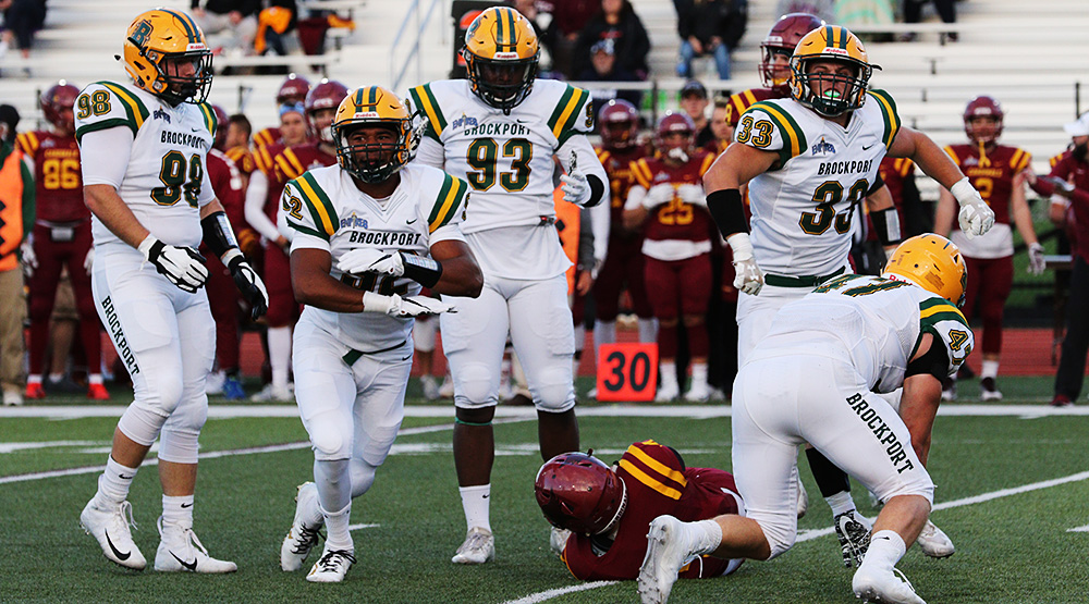 Brockport linebacker Tim Terry celebrates a tackle of a St. John Fisher player, along with defensive lineman John Tucci, left, defensive end Terry McDonald, linebacker Alex West and linebacker Matt Szymanski. (Brockport athletics file photo)