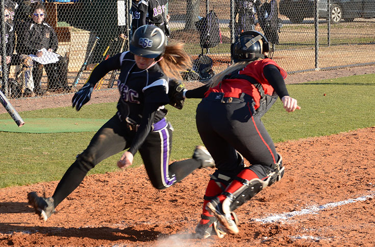 Catcher Emily Barrs tags out Agnes Scott's Alyssa Milliken in the first game of Friday's doubleheader.