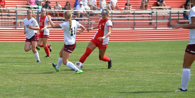 Ashley Henderson had two second half goals to lead the Cardinals to a victory over the Greyhounds...