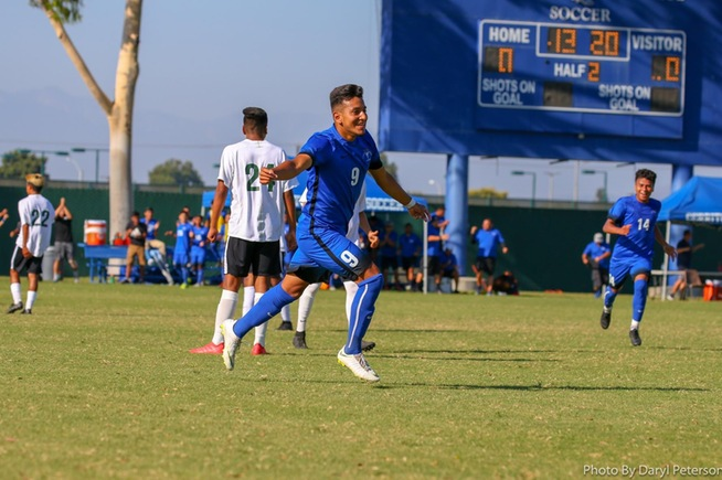 Kevin Diaz (9) celebrates after scoring the eventual game-winning goal
