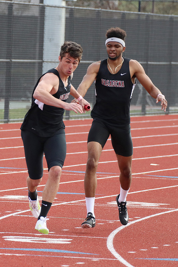 Lancer Brennan Doyle takes the baton from teammate Kalen Marshall during a relay race at the Cal State Los Angeles Invitational held March 3, photo by Richard Quinton.