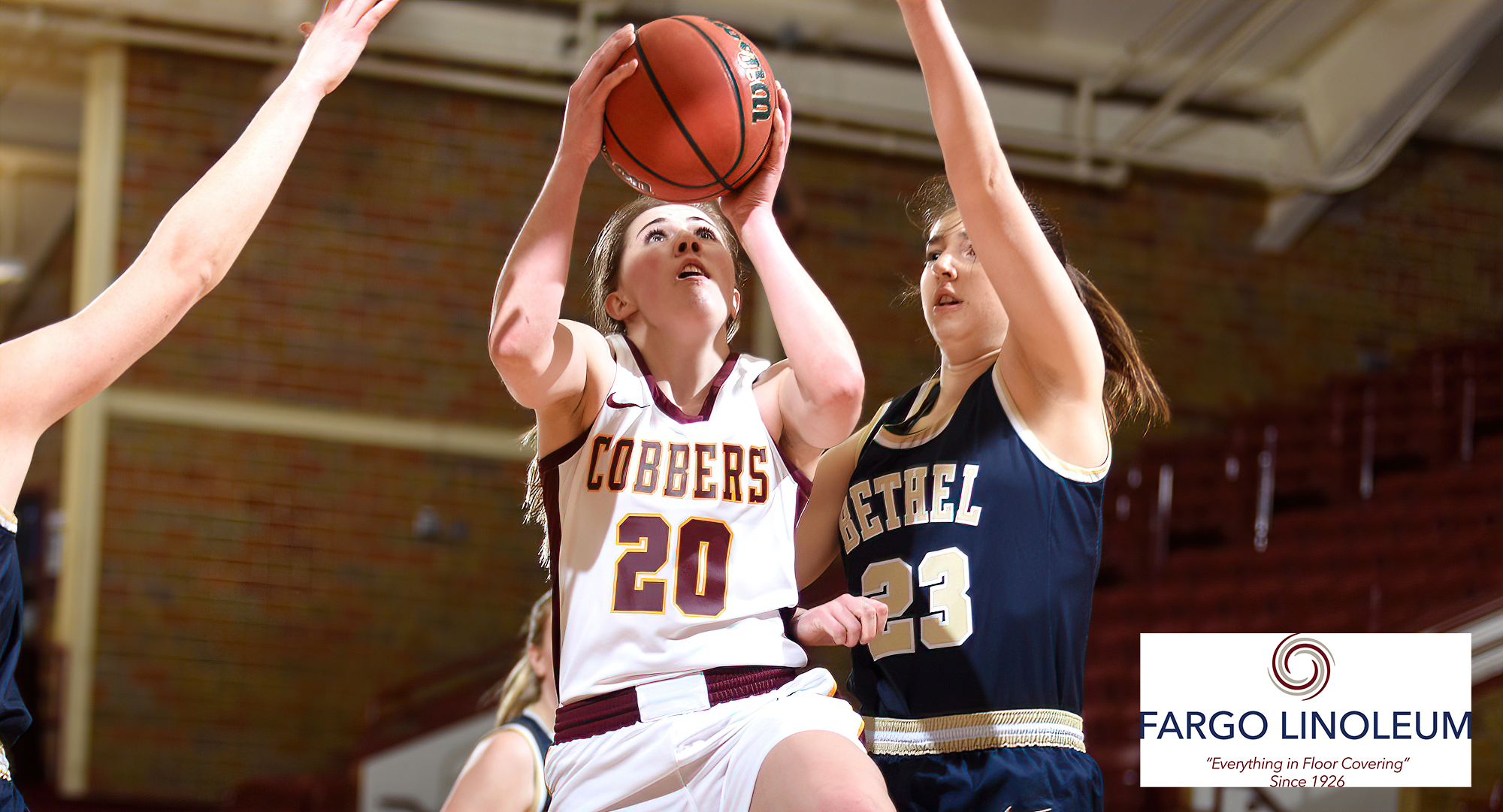 Emily Beseman drives the ball to the basket and goes up for two of her game-high 24 points in the first half of the Cobbers' win over Bethel.