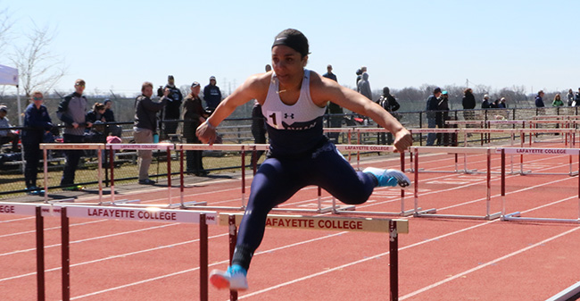 Amari Schooler '19 goes over a hurdle in the 100-meter hurdles at the Lafayette 8-Way Meet.